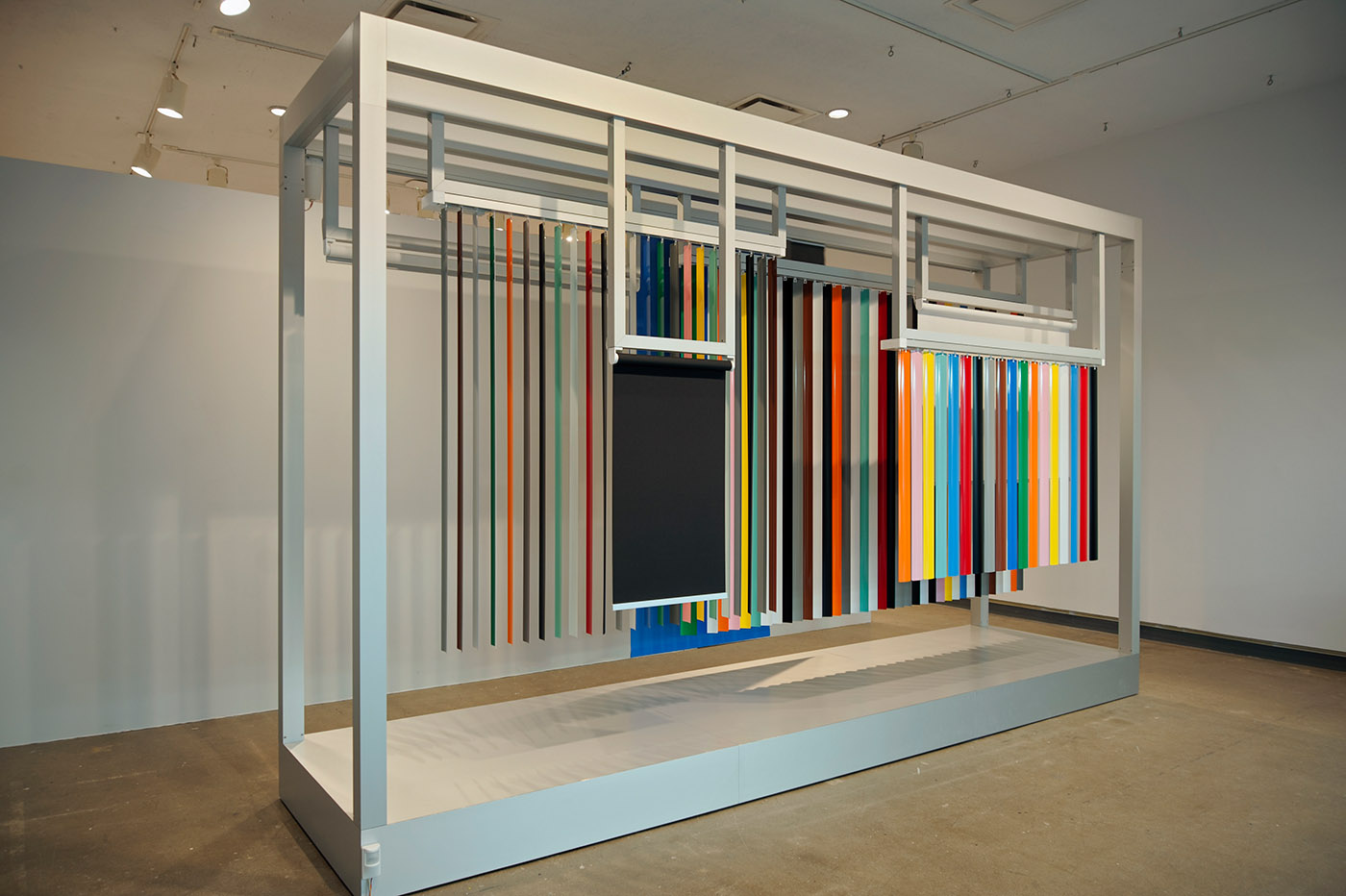 Jennifer Marman and Daniel Borins: Pavilion of the Blind (2013). Mechanized vertical blinds, shades, and panel systems (custom coloured), motors, microcontroller; 487.7  x 121.9 x 70 cm.