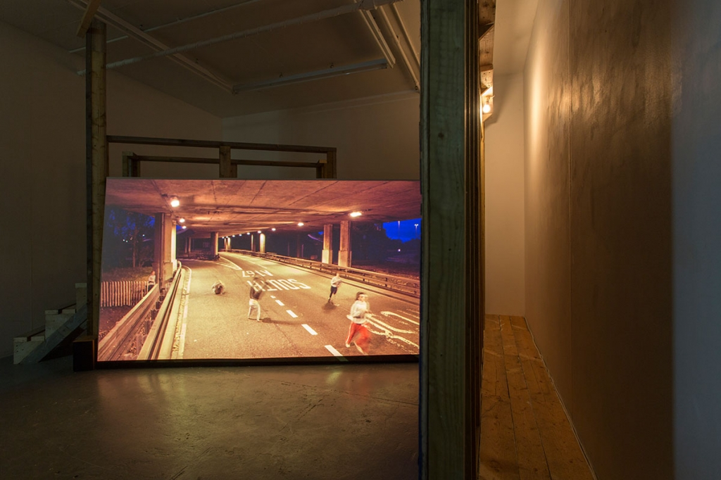 Melanie Manchot: Tracer (2013). Three-channel video, installation view.