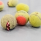 Claire Fontaine: Untitled (Tennis ball sculpture, 2008), installation view at Onsite [at] OCAD University, Toronto.