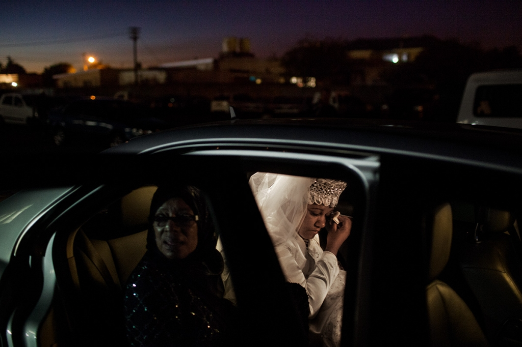 Cape Town, South Africa – March 3, 2013: Nazeera Nicolas cries in the car after leaving her wedding ceremony before heading to her new home at her husband's parents' home. Nazeera grew up in a Christian home and married a Muslim man, which is common in the area.