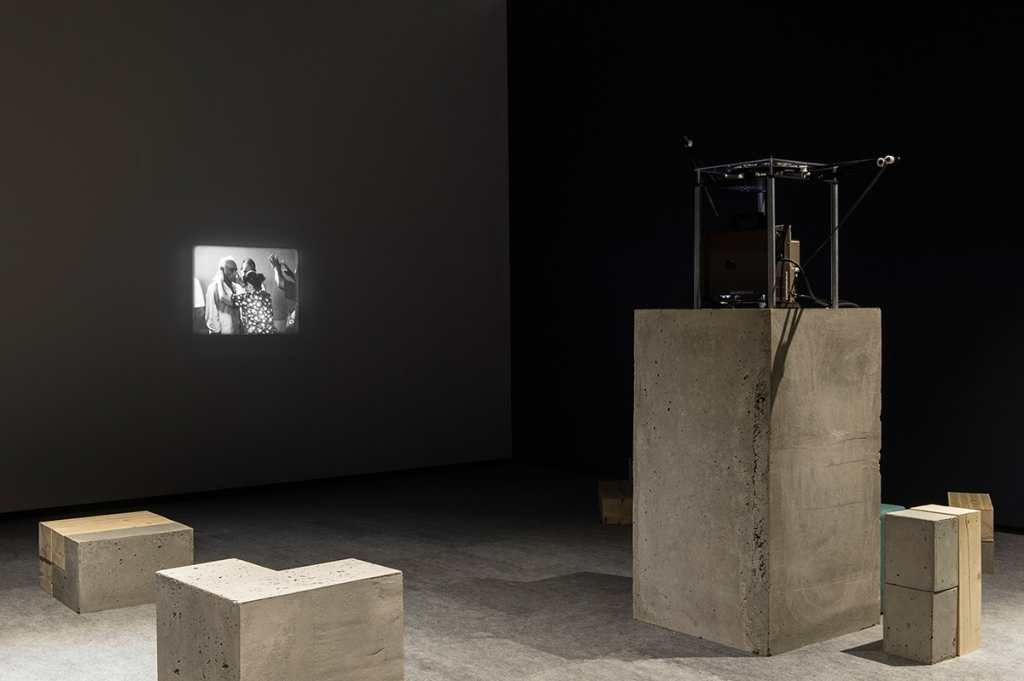 Tamar Guimarães and Kasper Akhøj: Installation view of A Família do Capitão Gervásio [Captain Gervasio's Family] (2013-2014). 16mm film, soundtrack, concrete plinth, concrete and reclaimed wood benches, 16 minutes, black and white. Walter Phillips Gallery, The Banff Centre. Courtesy of the artists.