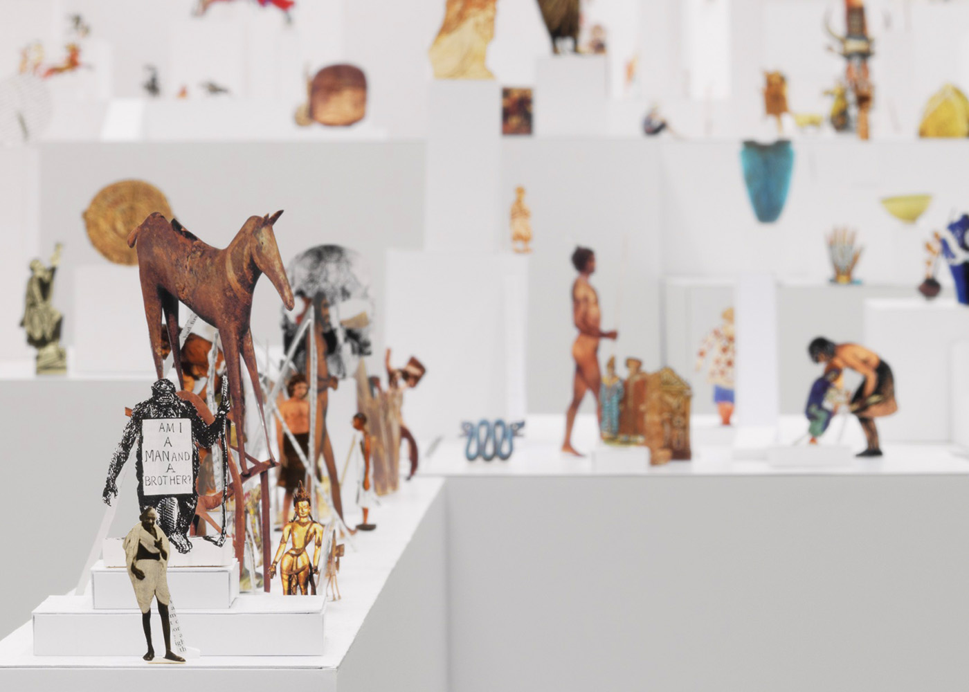 Geoffrey Farmer: The Last Two Million Years, 2007, exhibition copy, 2015 paper cut-outs from selected pages of The Last Two Million Years (foamcore plinths, Plexiglas frames, marble, incense).