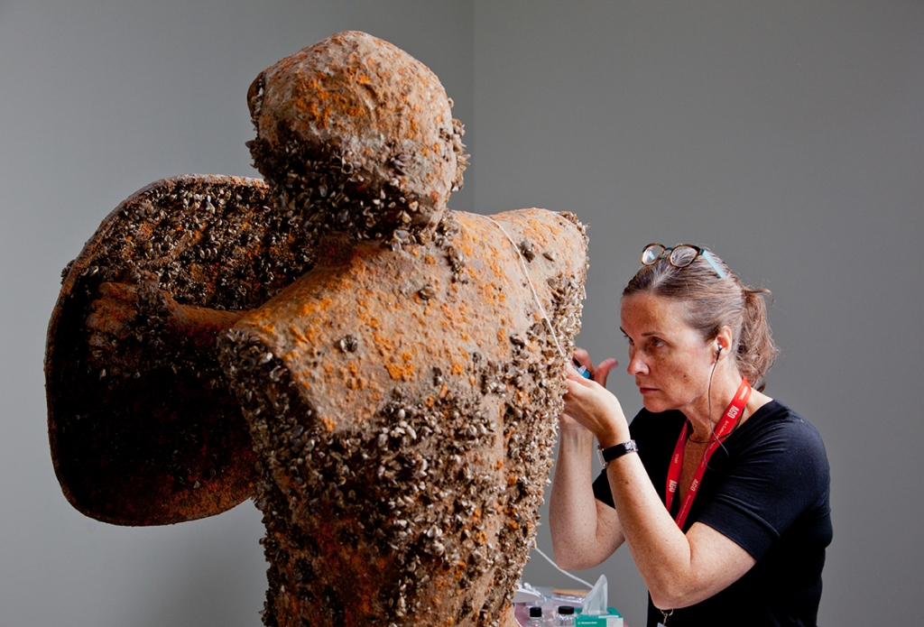 Contemporary art conservator Sherry Phillips at work on Simon Starling's Infestation Piece (Musselled Moore). Courtesy the Art Gallery of Ontario, Toronto. Photos: Dean Tomlinson.