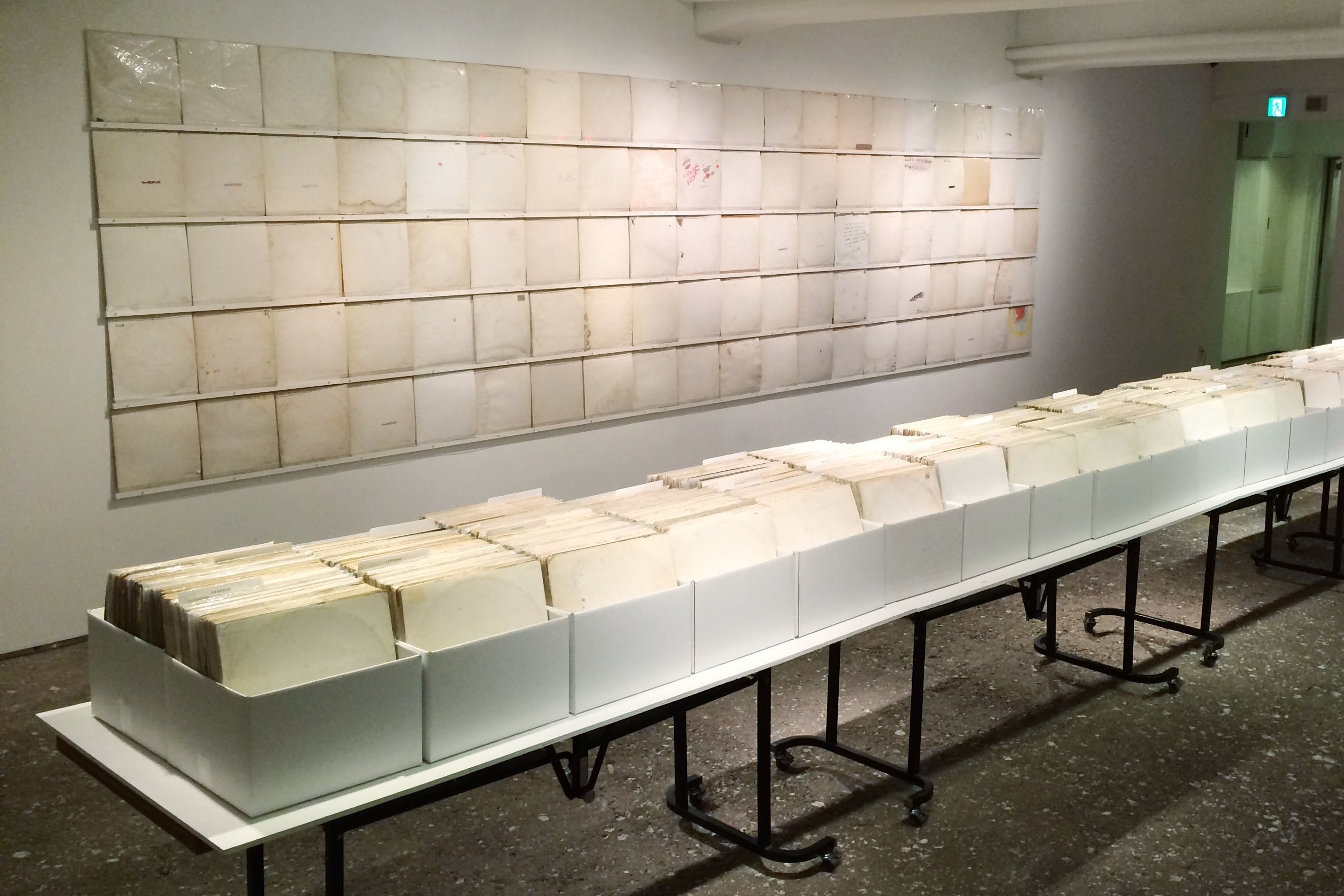 "Rutherford's ""We Buy White Albums"" on view at the Wonder Site Hongo, Tokyo (2015). Photo courtesy the artist."