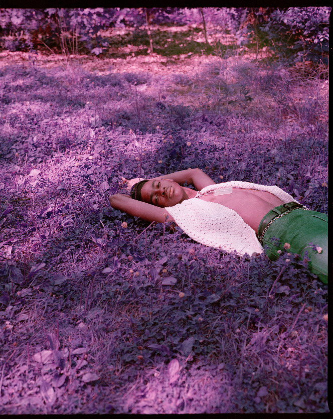 Photo by one of our mentors Brianna Roye, briannaroye.com, Lex Millington laying in a field at High Park